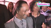 Katt Williams greets a fan while departing Scary Movie 5 Premiere in Hollywood