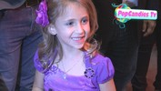 Ava Kolker greets fans while departing Scary Movie 5 Premiere in Hollywood